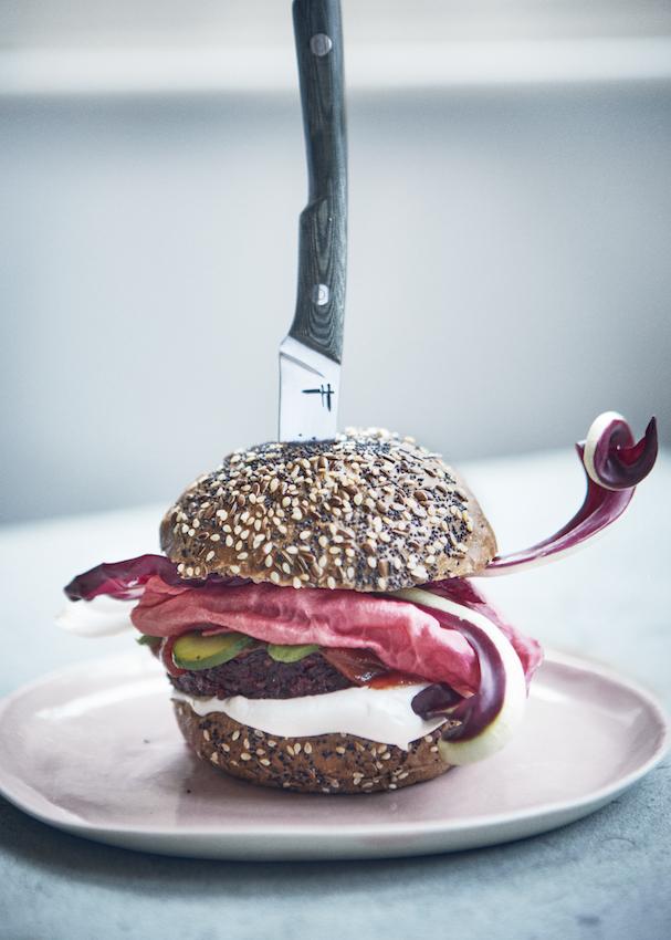 Vegan burger with a knife