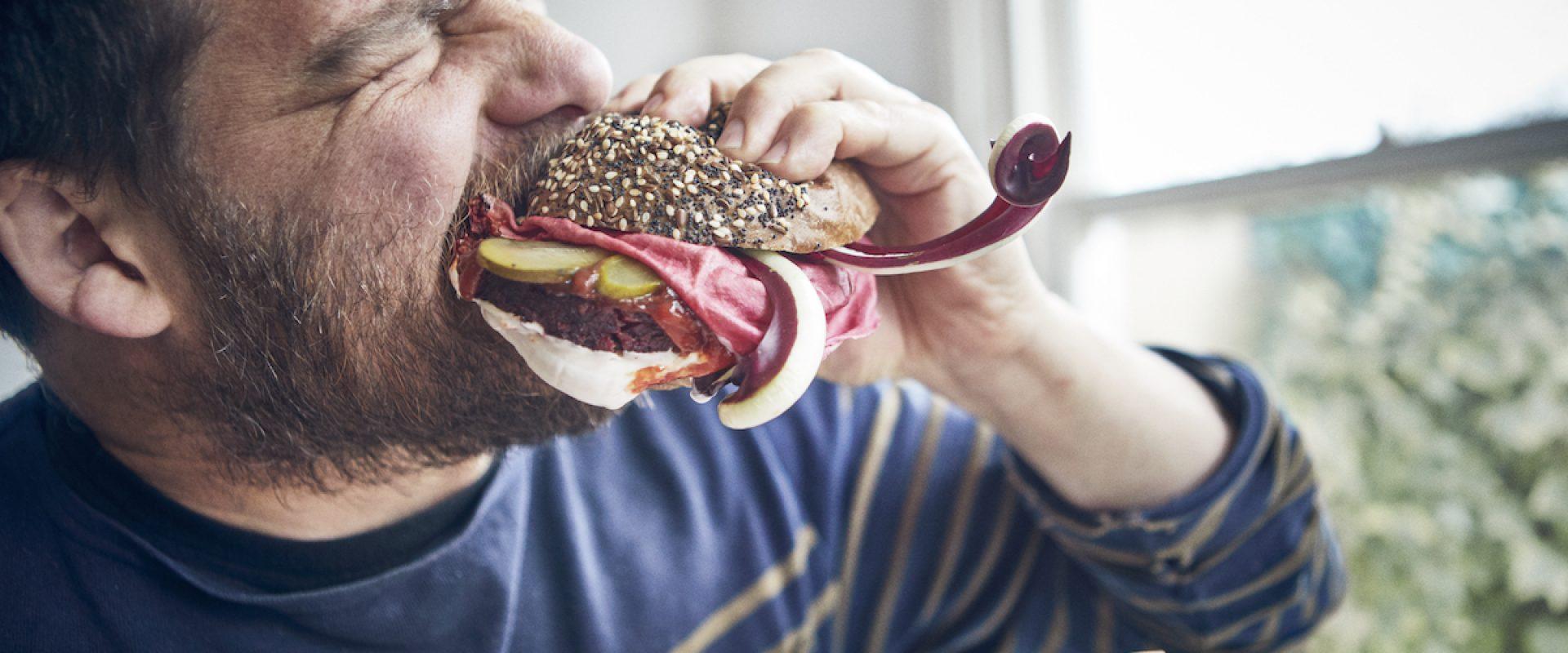 Tom Hunt eating a veggie burger